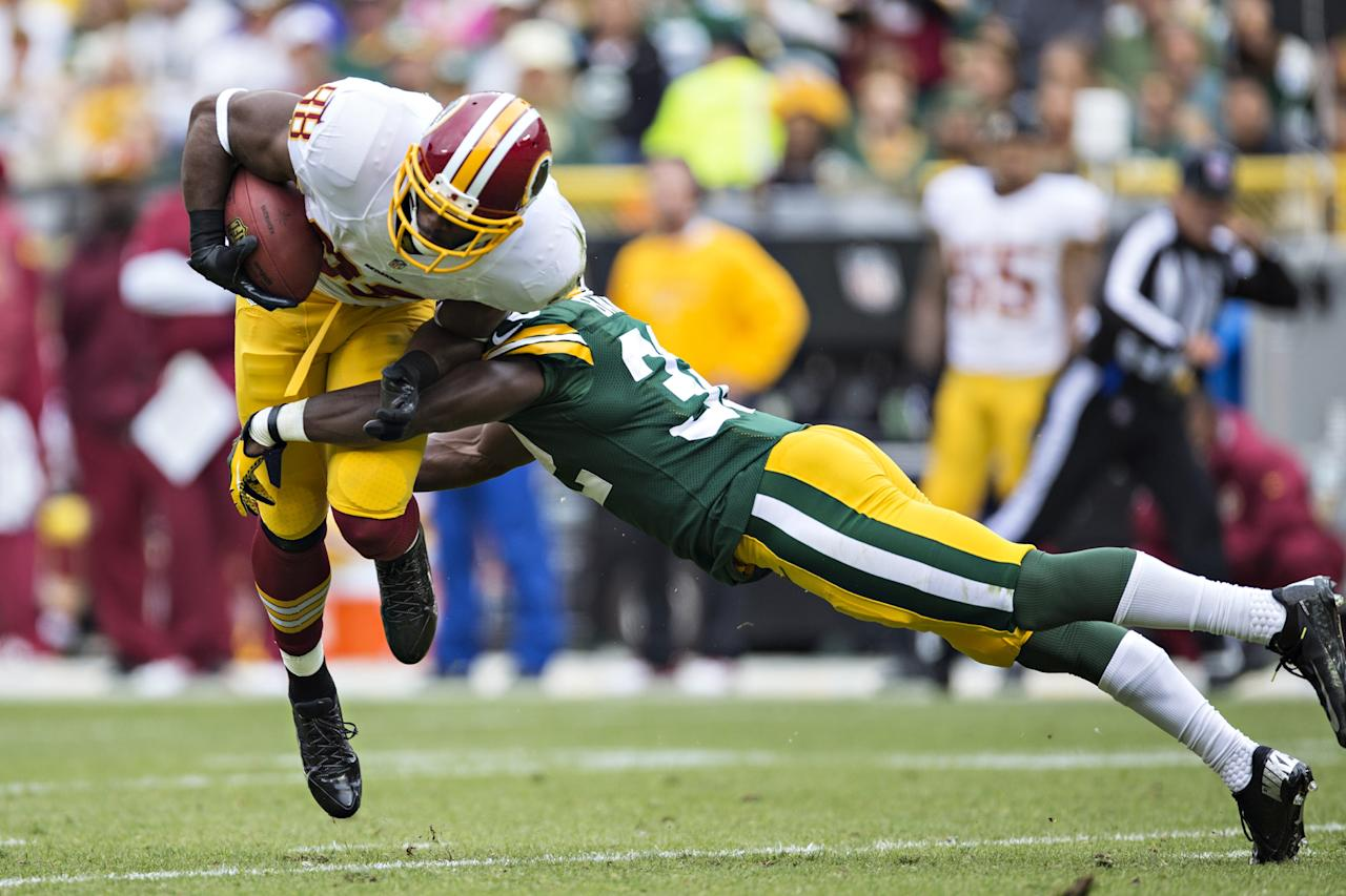 GREEN BAY, WI - SEPTEMBER 15: Jermichael Finley #88 of the Washington Redskins is tackled by Chris Banjo #32 of the Green Bay Packers at Lambeau Field on September 15, 2013 in Green Bay, Wisconsin. The Packers defeated the Redskins 38-20. (Photo by Wesley Hitt/Getty Images)