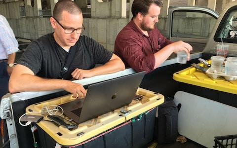 <span>Capital Gazette reporter Chase Cook (right) and photographer Joshua McKerrow work on the next days newspaper while awaiting news from their colleagues </span> <span>Credit: IVAN COURONNE/AFP </span>