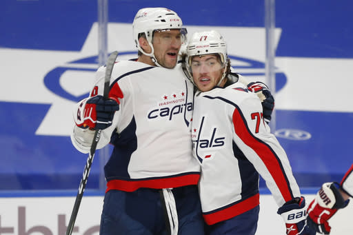 Washington Capitals forward T.J. Oshie, right, celebrates his goal with forward Alex Ovechkin, left, during the first period of an NHL hockey game against the Buffalo Sabres, Thursday, Jan. 14, 2021, in Buffalo, N.Y. (AP Photo/Jeffrey T. Barnes)
