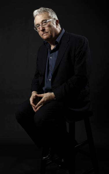 """FILE - This Feb. 7, 2011 file photo shows composer-songwriter Randy Newman posing for a portrait after the Academy Award Nominees Luncheon in Beverly Hills, Calif. Newman is weighing in on the presidential election, and he's playing the race card through a song he wrote. I'm Dreaming"""" is full of satirical, sarcastic _ and signature Newman _ anecdotes about someone who votes for the president because he is white. It features the refrain: """"I'm dreaming of a white president."""" Newman is openly supporting President Barack Obama. He says though the song is serious, he wants the public to find comedic relief in it. (AP Photo/Matt Sayles, File)"""