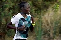 Lonah Chemtai, a Kenyan-born runner who will represent Israel in the women's marathon at the 2016 Rio Olympics, trains with her husband and coach, Israeli Dan Salpeter, near their house in Moshav Yanuv, central Israel July 14, 2016.REUTERS/Baz Ratner