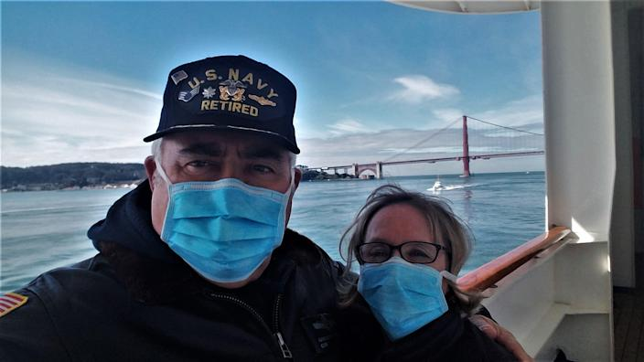 Greg and Cathy Rafanelli of Seattle stand on the Grand Princess cruise as they enter the San Francisco Bay after the coronavirus outbreak.