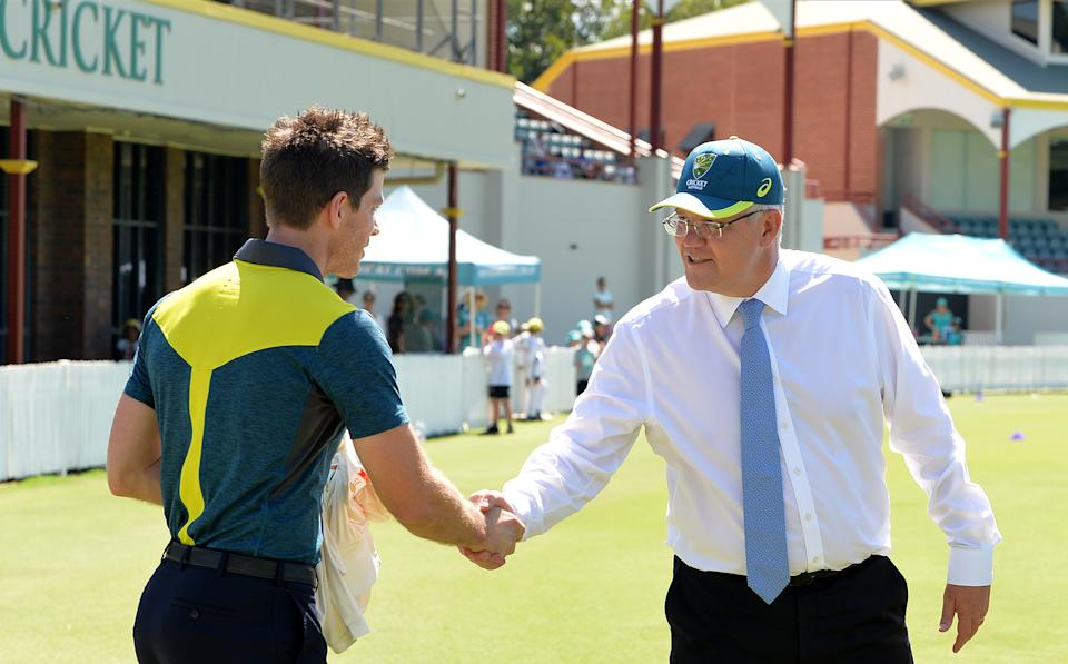 Prime Minister Scott Morrison (pictured right) shaking hands with Australian captain Tim Paine (pictured left).