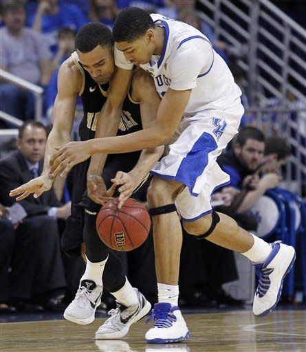 Vanderbilt forward Jeffery Taylor (44) and Kentucky forward Anthony Davis (23) fight for a loose ball during the second half of an NCAA college basketball game in the championship game of the 2012 Southeastern Conference tournament at the New Orleans Arena in New Orleans, Sunday, March 11, 2012. (AP Photo/Bill Haber)