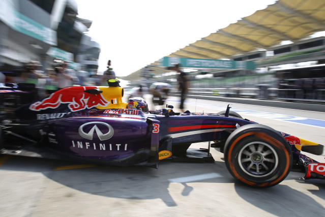Red Bull Racing driver Daniel Ricciardo of Australia leaves the pit during the first practice session ahead of Sunday's Malaysian Formula One Grand Prix at Sepang International Circuit in Sepang, Malaysia, Friday, March 28, 2014. (AP Photo/Lai Seng Sin)