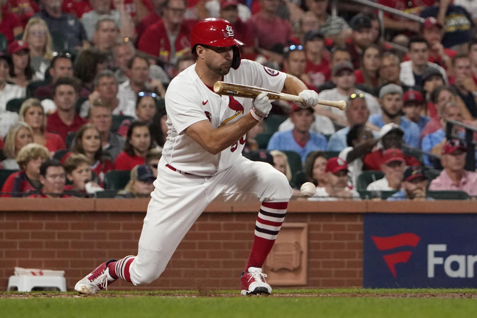 St. Louis Cardinals' Adam Wainwright hits a sacrifice bunt to score Harrison Bader during the fourth inning of a baseball game against the Milwaukee Brewers Tuesday, Sept. 28, 2021, in St. Louis. (AP Photo/Jeff Roberson)