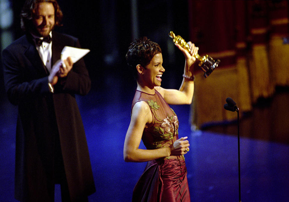 American actress Halle Berry accepts the Academy Award for Best Actress for her performance in