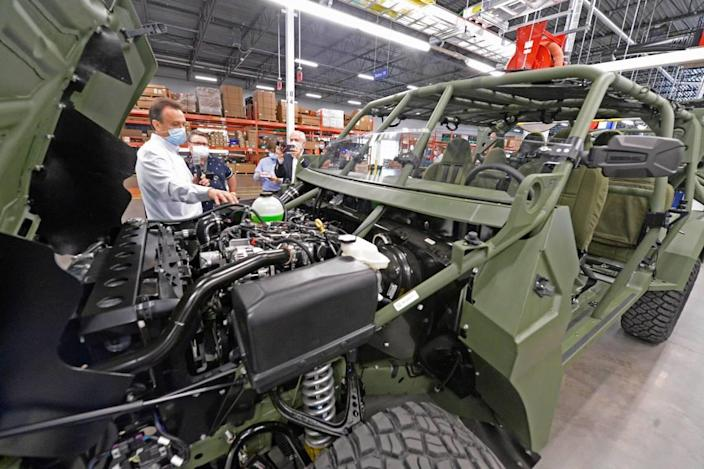 Ronald Kennedy, Quality Manager, GM Defense Concord Facility describes the production process on the assembly line of the new Infantry Squad Vehicle built for the U.S. Army at the GM Defense facility in Concord, NC, during a tour on Tuesday, May 4, 2021. The vehicle is an air-transportable high-speed, light utility vehicle based on the Chevrolet Colorado ZR2 platform.