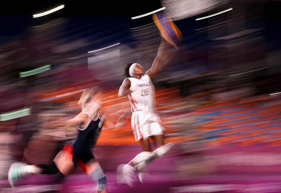 <p>Mamignan Toure of Team France drives to the basket on July 26 in the 3x3 basketball competition at Aomi Urban Sports Park.</p>