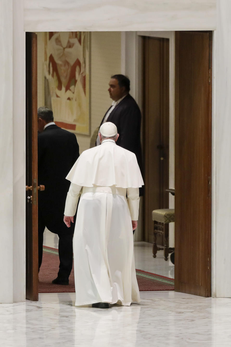 Pope Francis leaves at the end of his weekly general audience in the Pope Paul VI hall at the Vatican, Wednesday, Oct. 14, 2020. (AP Photo/Andrew Medichini)