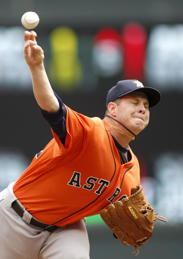 Houston Astros starting pitcher Brad Peacock throws to the Minnesota Twins in the first inning of their baseball game in Minneapolis, Sunday, Aug. 4, 2013. (AP Photo/Andy Clayton-King)