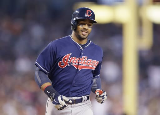 Cleveland Indians' Chris Dickerson rounds the bases after a solo home run off Detroit Tigers starting pitcher Max Scherzer during the sixth inning in the second baseball game of a doubleheader, Saturday, July 19, 2014 in Detroit. (AP Photo/Carlos Osorio)