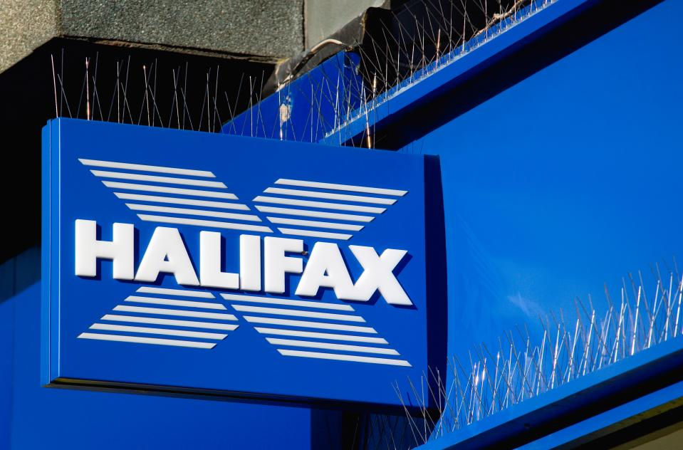 Business. Finance. Banking. Halifax sign on high street bank building with metal pigeon control spikes above it. (Photo by: Pauleheult/Eye Ubiquitous/Universal Images Group via Getty Images)