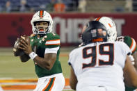 Miami quarterback D'Eriq King (1) looks for a receiver as Oklahoma State defensive tackle Sione Asi (99) rushes during the first half of the Cheez-it Bowl NCAA college football game, Tuesday, Dec. 29, 2020, in Orlando, Fla. (AP Photo/John Raoux)