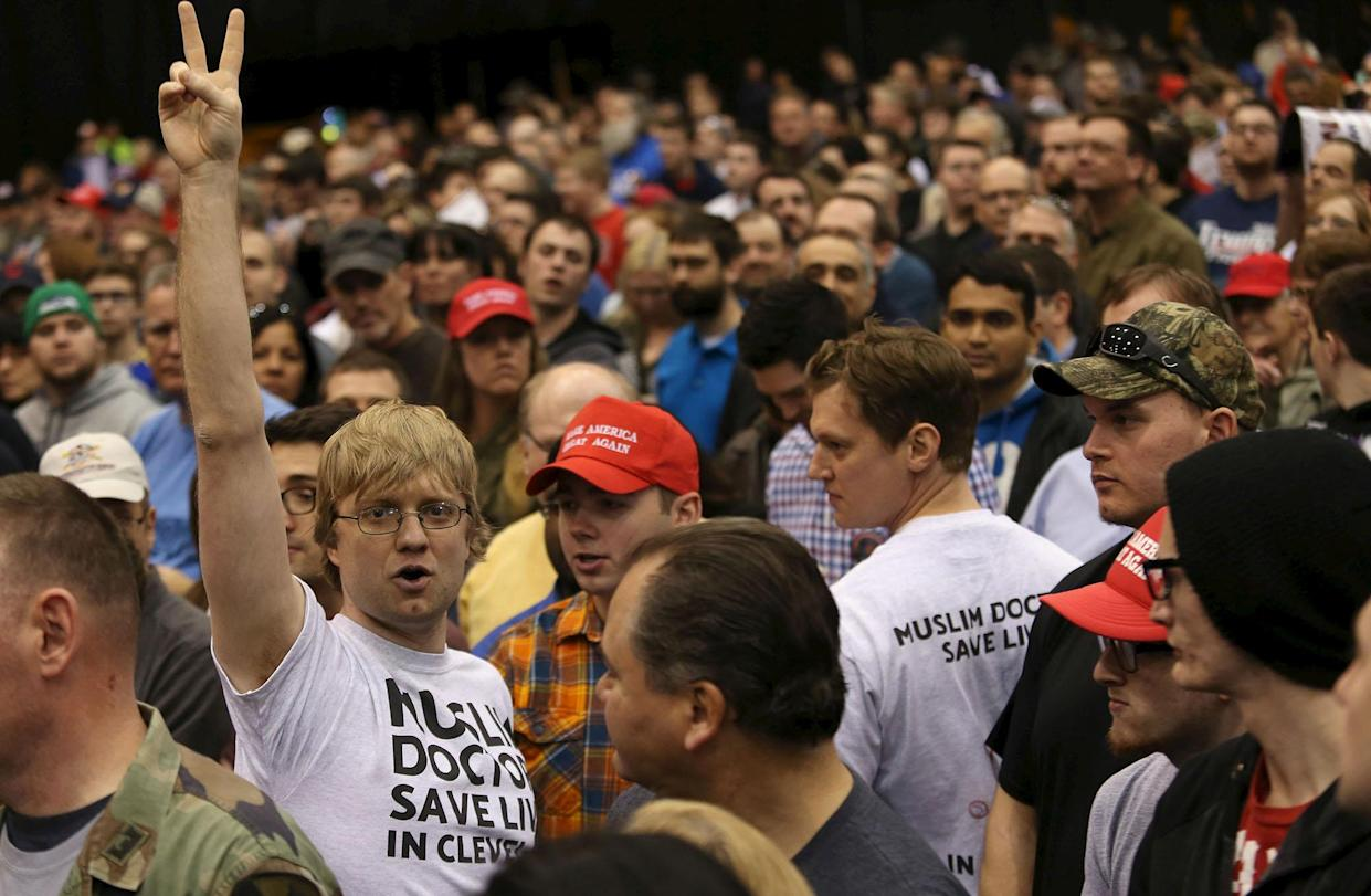 Bryan Hambley, left, is removed from the crowd as Donald Trump speaks at a campaign rally in Cleveland on March 12. (Photo: Aaron Josefczyk/Reuters)