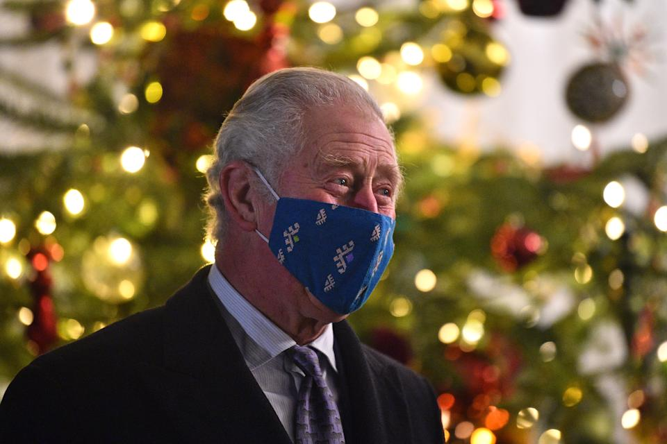 WINDSOR, ENGLAND - DECEMBER 08: Prince Charles, Prince of Wales wearing a protective face covering to combat the spread of the coronavirus, attends an event to thank local volunteers and key workers for the work they are doing during the coronavirus pandemic and over Christmas in the quadrangle of Windsor Castle on December 8, 2020 in Windsor, England.  The Queen and members of the royal family gave thanks to local volunteers and key workers for their work in helping others during the coronavirus pandemic and over Christmas at Windsor Castle in what was also the final stop for the Duke and Duchess of Cambridge on their tour of England, Wales and Scotland. (Photo by Glyn Kirk - WPA Pool/Getty Images)