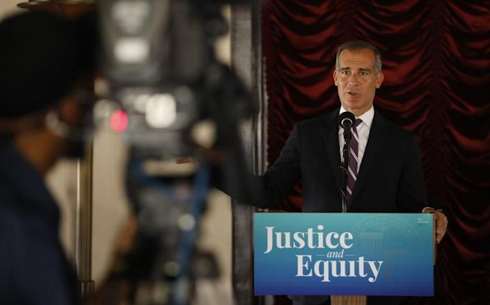 LOS ANGELES, CA - JUNE 02: Los Angeles Mayor Eric Garcetti addresses a press conference while he signs his 2021-2022 budget flanked by LA City council members in the Tom Bradley room of Los Angeles City Hall on Wednesday June 2, 2021. City Hall on Wednesday, June 2, 2021 in Los Angeles, CA. (Al Seib / Los Angeles Times).