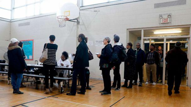 PHOTO: People wait in line to get their ballot to vote in the Michigan primary election at Chrysler Elementary School in Detroit, March 10, 2020. (Jeff Kowalsky/AFP/Getty Images)