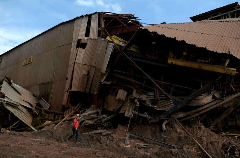 FILE PHOTO: A member of a rescue team walks next to a collapsed tailings dam owned by Brazilian mining company Vale in Brumadinho