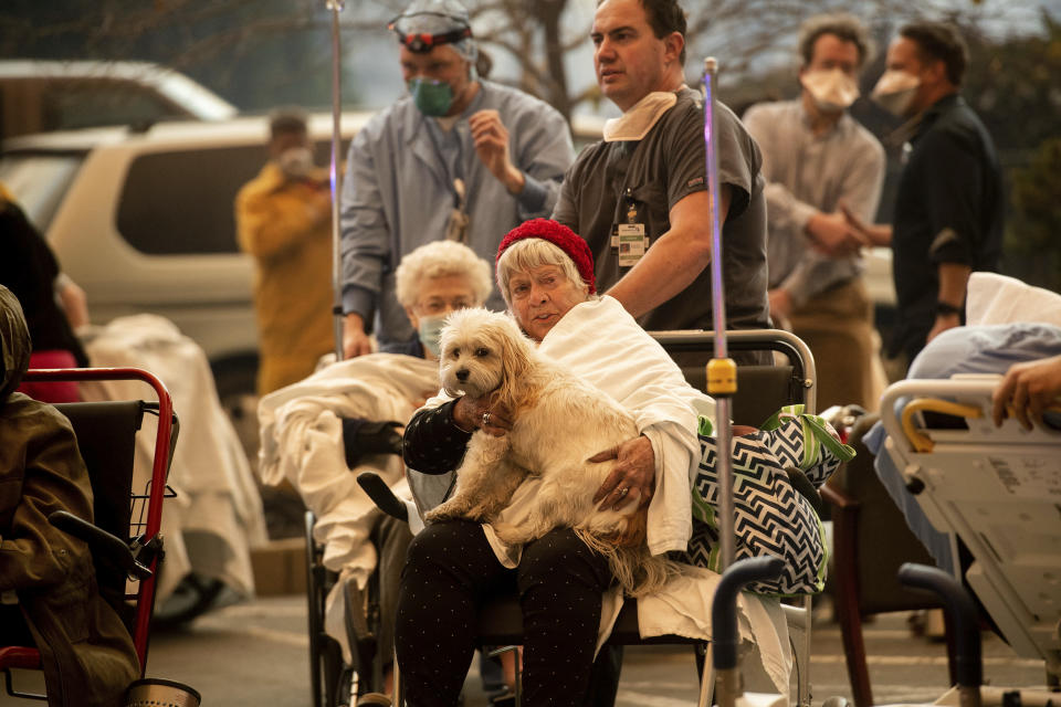 Patients are evacuated from the hospital in Paradise, California (AP Images)