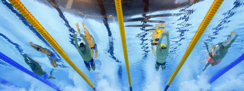 FILE - In this Saturday, Aug. 6, 2016 file photo, Italy's Gabriele Detti, from left, United States' Conor Dwyer, Australia's Mack Horton and China's Sun Yang compete in the final of the men's 400-meter freestyle during the swimming competitions at the 2016 Summer Olympics, in Rio de Janeiro, Brazil. One of China's biggest Olympic stars will undergo a rare public trial of a doping case on Friday, Nov. 15, 2019 with his 2020 Tokyo Games place at stake. Three-time gold medalist swimmer Sun Yang is facing a World Anti-Doping Agency appeal in Switzerland that seeks to ban him for up eight years.  (AP Photo/David J. Phillip, File)