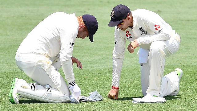 Joe Root checks out the damage. Image: Getty