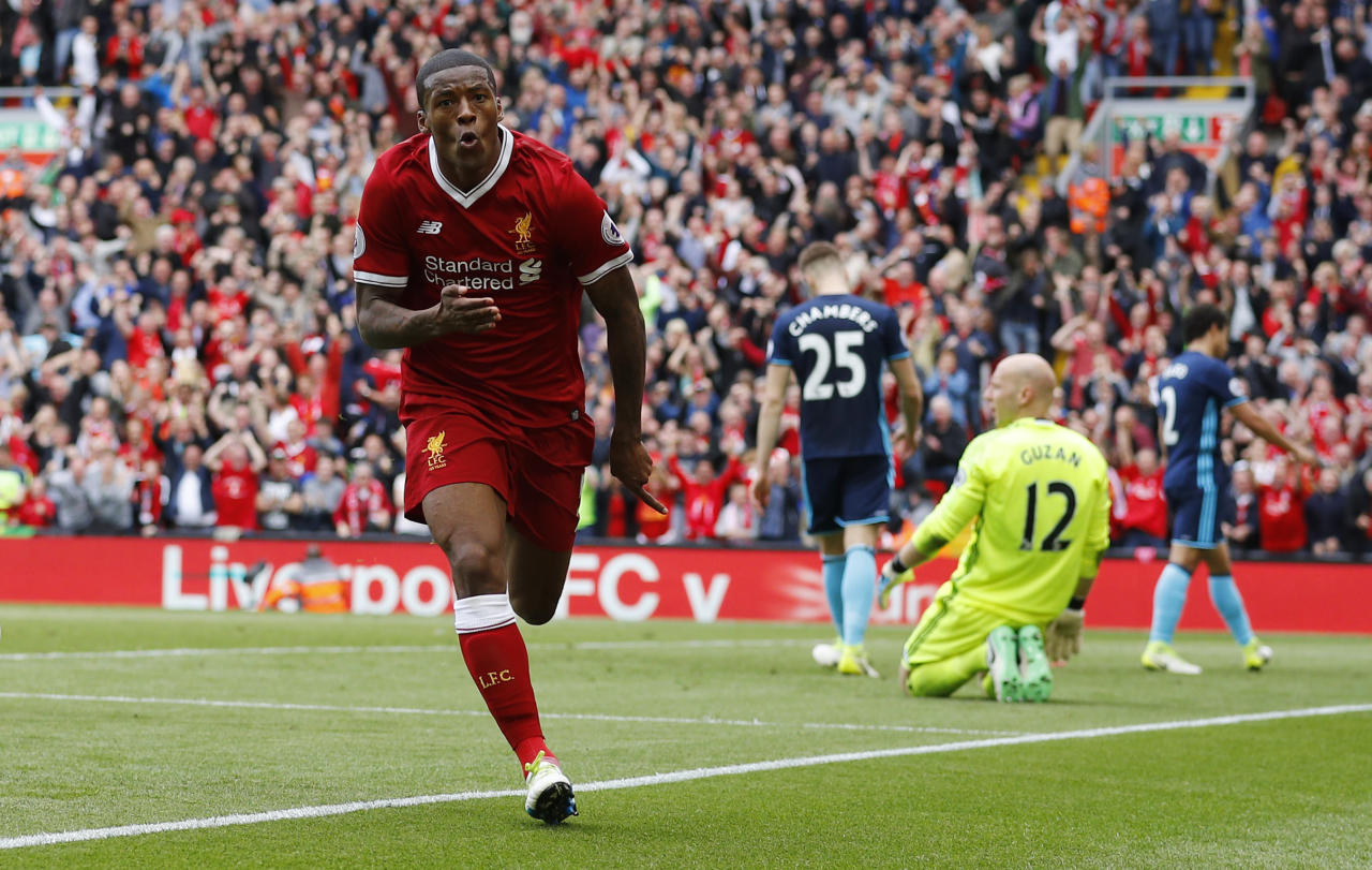"Britain Football Soccer - Liverpool v Middlesbrough - Premier League - Anfield - 21/5/17 Liverpool's Georginio Wijnaldum celebrates scoring their first goal as Middlesbrough's Brad Guzan looks dejected  Reuters / Phil Noble Livepic EDITORIAL USE ONLY. No use with unauthorized audio, video, data, fixture lists, club/league logos or ""live"" services. Online in-match use limited to 45 images, no video emulation. No use in betting, games or single club/league/player publications.  Please contact your account representative for further details."