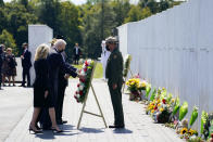 President Joe Biden and first lady Jill Biden lay a wreath at the Wall of Names during a visit to the Flight 93 National Memorial in Shanksville, Pa., Saturday, Sept. 11, 2021. The Bidens visited to commemorate the 20th anniversary of the Sept. 11, 2001, terrorist attacks. Gordon Felt, brother of Edward Porter Felt and President of Families for Flight 93, third from right, Calvin Wilson the brother-in-law of First Officer LeRoy Homer, a passenger on Flight 93, second from right, and National Park Service park ranger Robert Franz, right, look on. (AP Photo/Evan Vucci)