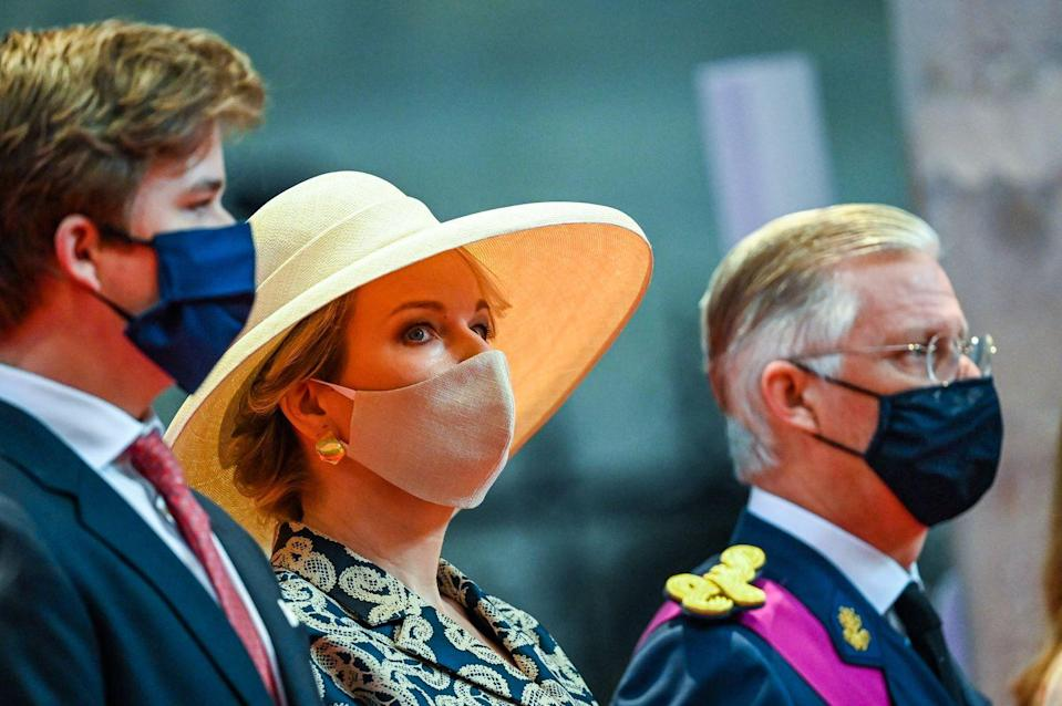 <p>Queen Mathilde accessorized her patterned dress with a wide-brimmed hat and large gold earrings.</p>
