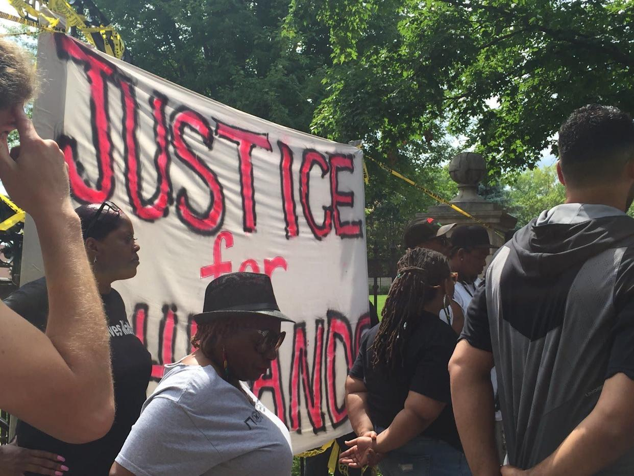 People protest outside the Minnesota Governor's Residence in St. Paul Minnesota on July 7, 2016.