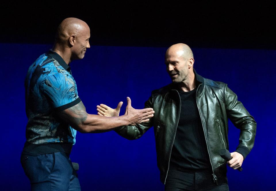 Actors Dwayne Johnson (L) and Jason Statham appear on stage during the CinemaCon Universal Pictures special presentation at the Colosseum Caesars Palace on April 3, 2019, in Las Vegas, Nevada. (Photo by VALERIE MACON / AFP)        (Photo credit should read VALERIE MACON/AFP/Getty Images)