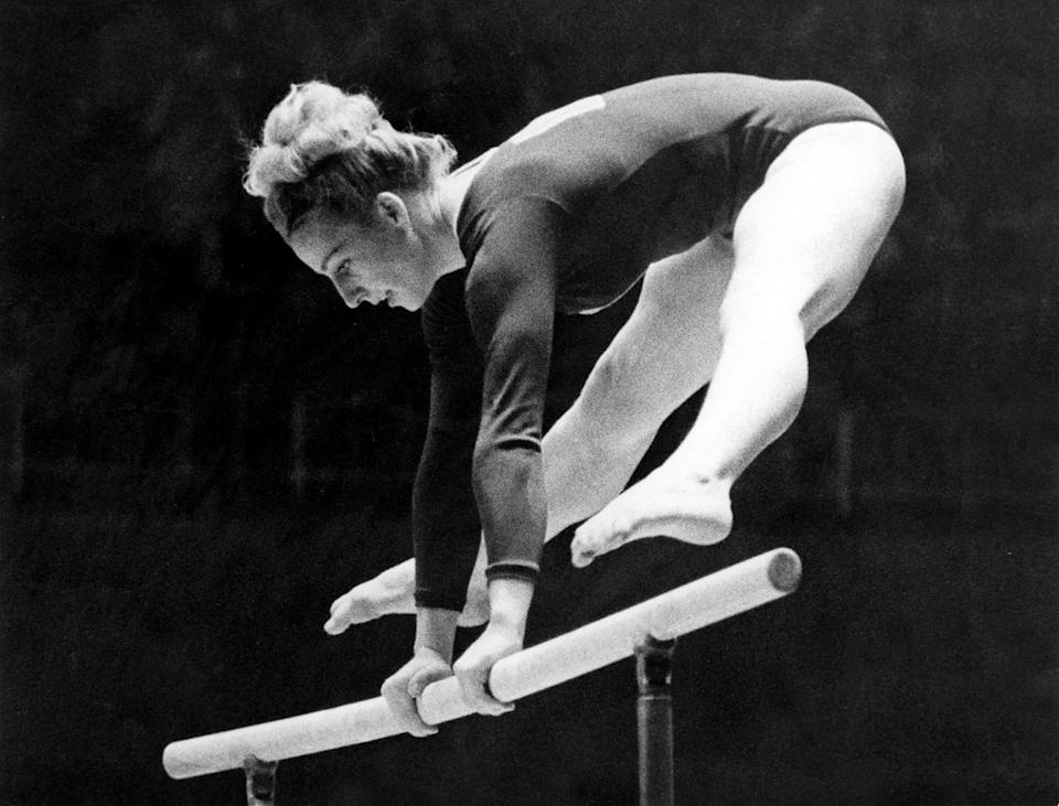 <p>V?ra ?áslavská of Czechoslovakia performs on the parallel bars during the women's Olympic individual gymnastic classification at the 1964 Tokyo Olympics. (AP Photo) </p>