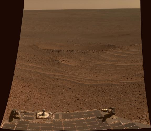 "NASA's Mars Exploration Rover Opportunity shows a view of ""Lunokhod Crater,"" lying south of Solander Point on the west rim of Endeavour Crater. This image was taken on April 24, 2014 and released on July 28."