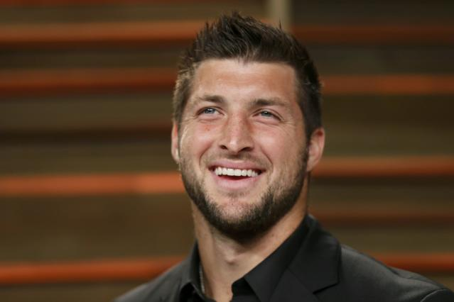 Former NFL player Tim Tebow arrives at the 2014 Vanity Fair Oscars Party in West Hollywood, California March 2, 2014. REUTERS/Danny Moloshok (UNITED STATES TAGS: ENTERTAINMENT SPORT FOOTBALL) (OSCARS-PARTIES)