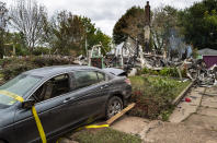 The remains of a home that burned still smolders in Manville, N.J., Sunday, Sept. 5, 2021, in the wake of the remnants of Hurricane Ida. Flood-stricken families and business owners across the Northeast are hauling waterlogged belongings to the curb and scraping away noxious mud as cleanup from Ida moves into high gear. (AP Photo/Craig Ruttle)