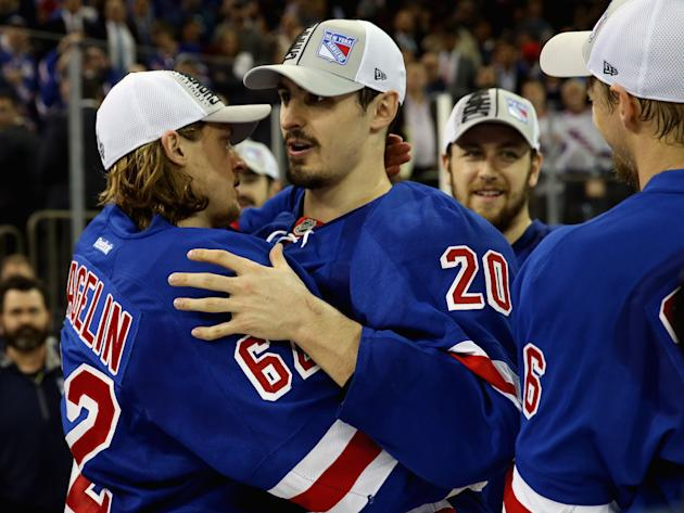 NEW YORK, NY - MAY 29: Carl Hagelin #62 and Chris Kreider #20 of the New York Rangers celebrates after defeating the Montreal Canadiens in Game Six to win the Eastern Conference Final in the 2014 NHL Stanley Cup Playoffs at Madison Square Garden on May 29, 2014 in New York City.Rangers defeated the Candiens 1-0. (Photo by Bruce Bennett/Getty Images)