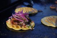 Tacos prepared by chef Mike Winneker appear at a makeshift kitchen outside of his home on April 3, 2021, in Scottsdale, Ariz. Beaten down by the pandemic, many laid-off or idle restaurant workers have pivoted to dishing out food with a taste of home. Some have found their entrepreneurial side, slinging their culinary creations from their own kitchens. (AP Photo/Ross D. Franklin)