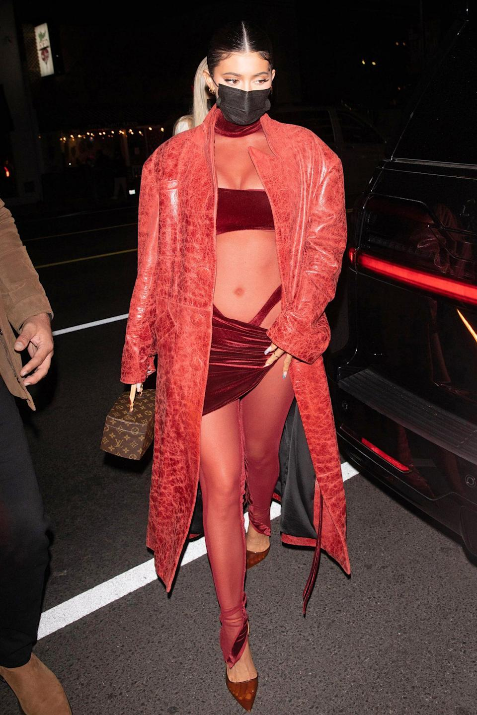 <p>Kylie Jenner arrives at Justin Bieber's album release party in an eye-catching jumpsuit featuring sheer panels and cut-outs on Thursday at The Nice Guy in L.A.</p>
