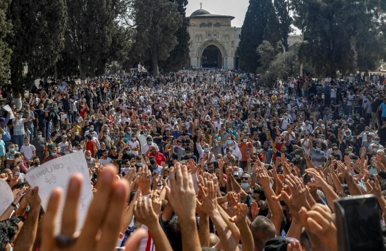 Palestinians protest in the al-Aqsa mosque compound against Macron's defence of the Mohammed cartoons