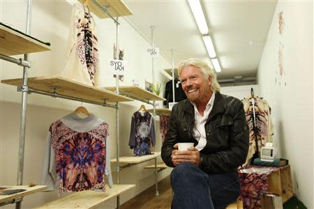 Sir Richard Branson, Founder of Virgin Group, is interviewed by Reuters about the Virgin StartUp scheme for young entrepreneurs, at Box Park in east London, October 24, 2013. REUTERS/Olivia Harris