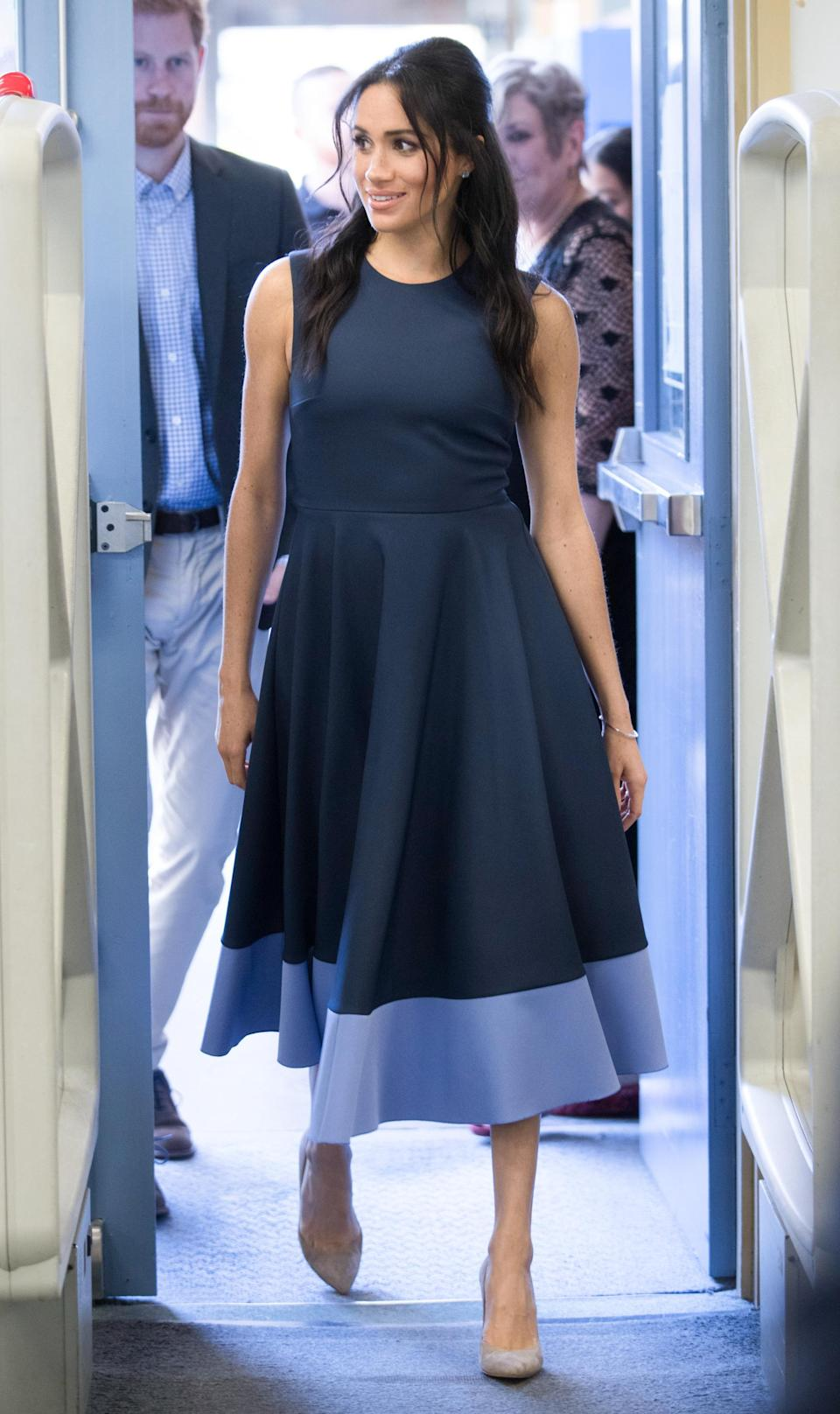 <p>For a visit to Macarthur Girls High School in Sydney, the Duchess wore a £1,299 A-line dress by Roksanda. She paired it with a pair of beige Stuart Weitzman Legend pumps, a white-gold Birks bracelet and Birks blue topaz earrings. <em>[Photo: Getty]</em> </p>