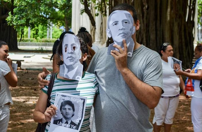 Cuban dissidents wear masks depicting US President Barack Obama as they protest against the reopening of the US embassy in the island in a park of Havana, August 9, 2015 (AFP Photo/Francisco Jara)