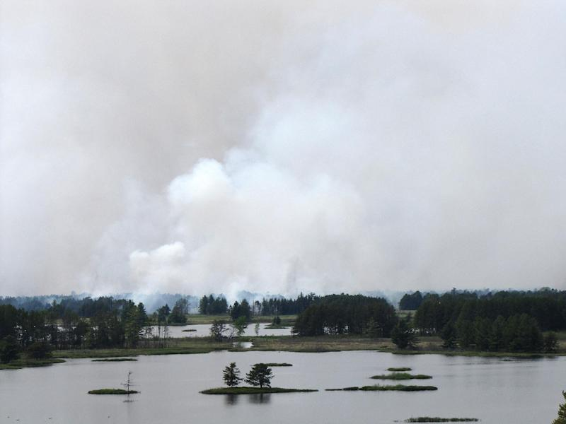 This photo released by the U.S. Fish and Wildlife Service shows the Pine Creek North wildfire at Seney National Wildlife Refuge in Seney, Mich. Wednesday, May 23, 2012. The wildfire in Michigan's Upper Peninsula has burned at least 1,500 acres of a wildlife refuge, leading to the expected closing of some trails and roads through the Memorial Day weekend. (AP Photo/U.S. Fish and Wildlife Service)