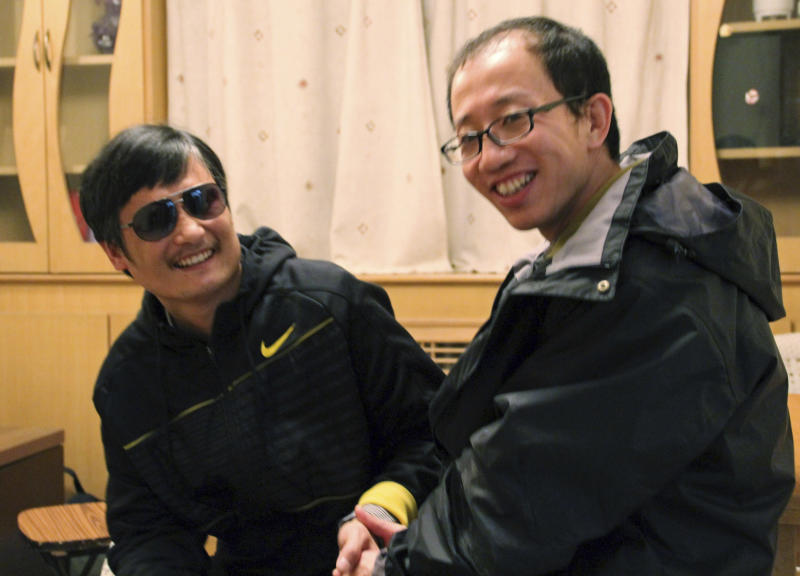 In this photo taken in late April, 2012, and provided by Hu Jia, blind Chinese legal activist Chen Guangcheng, left, meets with Hu at an undisclosed location. Chen, an inspirational figure in China's rights movement, slipped away from his well-guarded rural village on Sunday night, April 22, 2012, and made it to a secret location in Beijing on Friday, April 27, setting off a frantic police search for him and those who helped him, activists said. (AP Photo/Courtesy of Hu Jia)