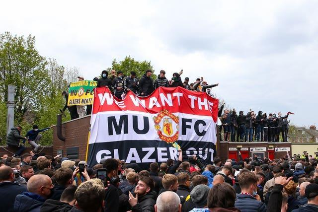 Manchester United fans protest against the club's owners
