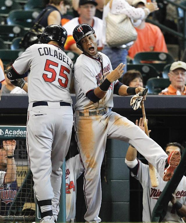 Minnesota Twins' Chris Colabello (55) celebrates with Pedro Florimon (25) after hitting a grand slam home run against the Houston Astros in the ninth inning of a baseball game, Monday, Sept. 2, 2013, in Houston. The Twins won 10-6. (AP Photo/Bob Levey)