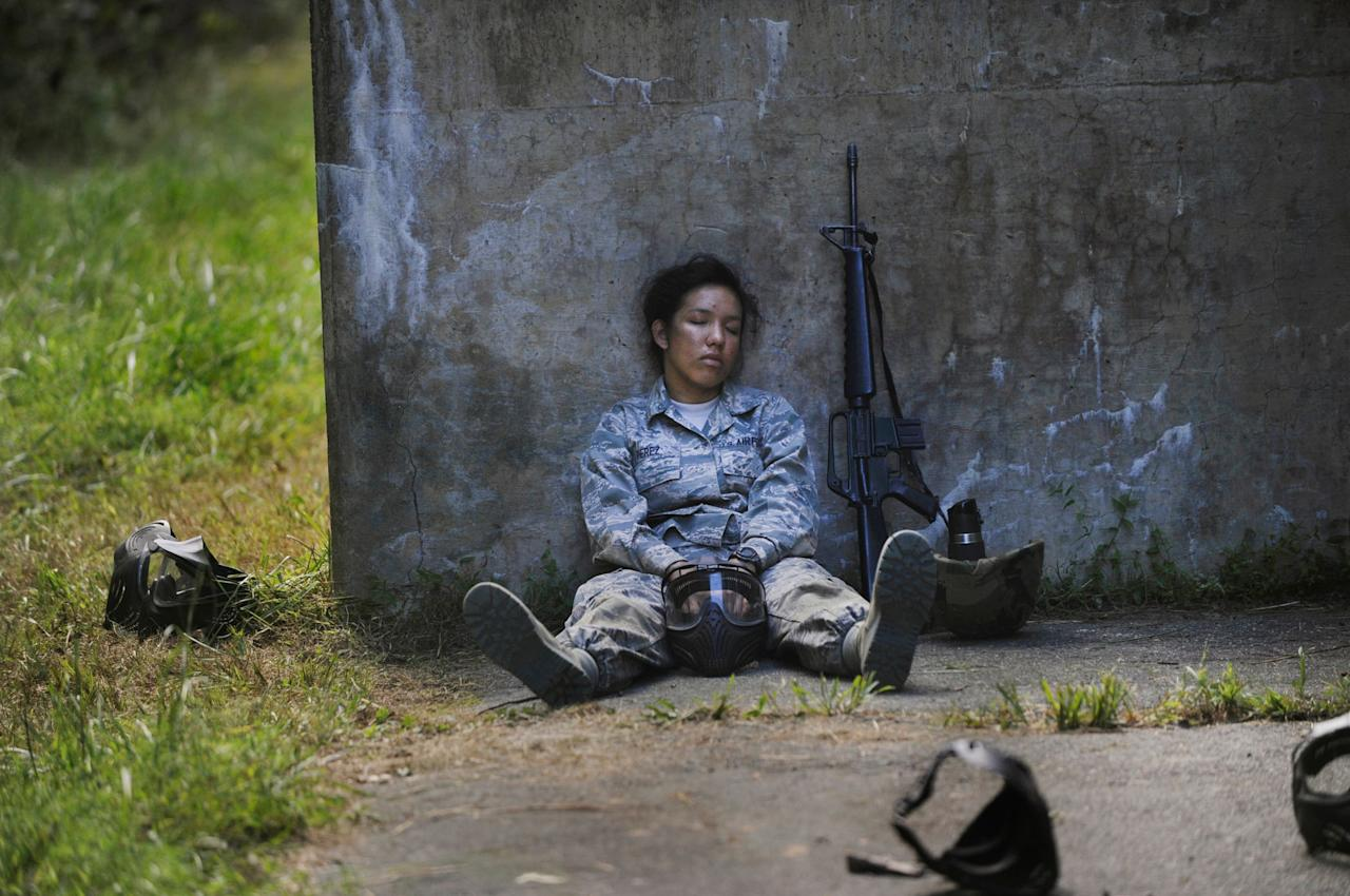 Airman Basic Rebecca Perez briefly closes her eyes during a field training exercise at Fort George G. Meade, Maryland (Val Gempis/USAF/Rex Features)