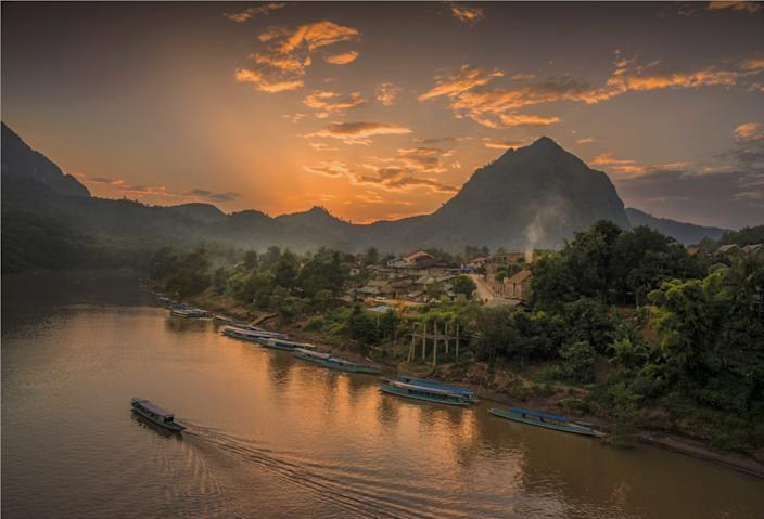 Dusk on the Nam Ou River in the province of Luang Prabang, Laos.