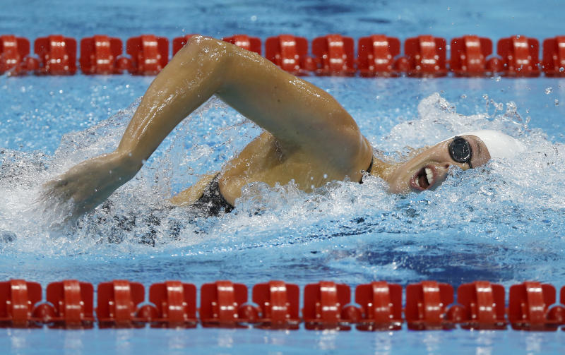 France's Camille Muffat  competes in a women's 400-meter freestyle swimming heatat the 2012 Summer Olympics, Sunday, July 29, 2012, in London. (AP Photo/Daniel Ochoa De Olza)