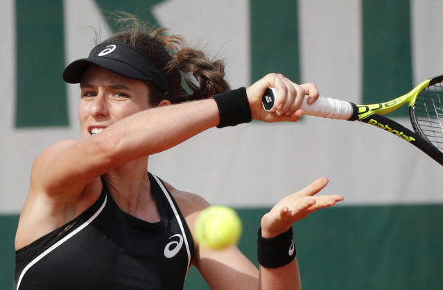 Britain's Johanna Konta slams a forehand to Kazakhstan's Yulia Putintseva during their first round match of French Open tennis tournament at the Roland Garros Stadium, Sunday, May 27, 2018 in Paris. (AP Photo/Christophe Ena)